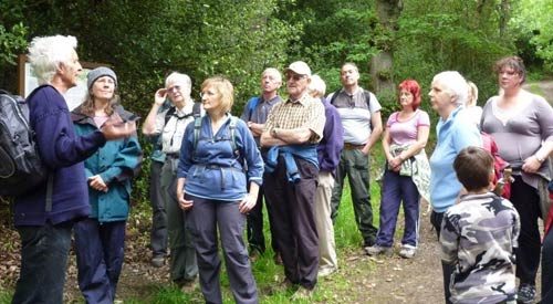 Walkers at the entrance to Broadhead Clough Nature Reserve